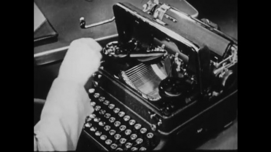 1940s: UNITED STATES: hand brushes workings of typewriter.