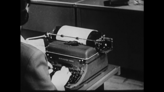 1940s: UNITED STATES: lady types on typewriter. Lady pulls out paper from machine. Lady fixes mistake on paper.