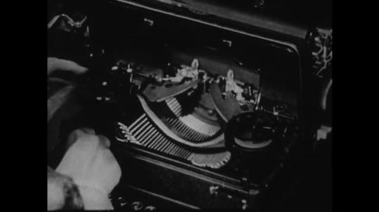 1940s: UNITED STATES: hands repair typewriter ribbon. Lady closes typewriter lid.