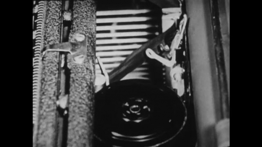 1940s: UNITED STATES: close up of ribbon ink inside typewriter. Pencil points at ribbon.