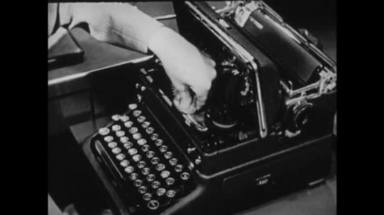 1940s: UNITED STATES: lady dabs sponge inside typewriter. Lady cleans typewriter.