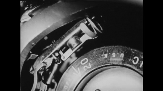 1940s: UNITED STATES: pencil points at measurement inside typewriter