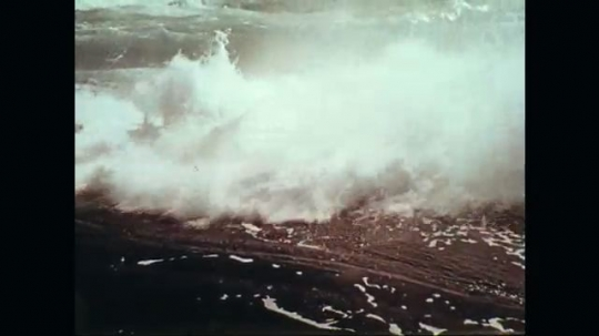 1970s: Waves crashing against rocks.