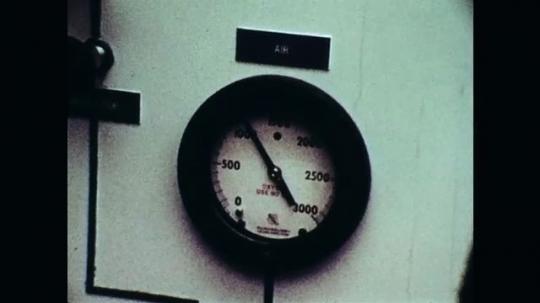 1970s: Close up of gauge. Close up of man