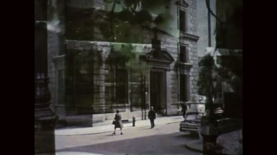 1960s: UNITED STATES: people walk by city building. People outside bank. Men in boardroom meeting