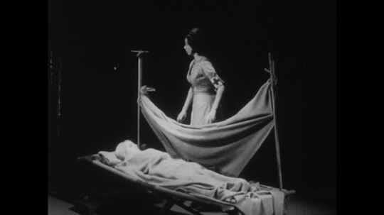 1950s: Assistant nurse uses blanket to create bed rail to prevent that patient falls out the bed.