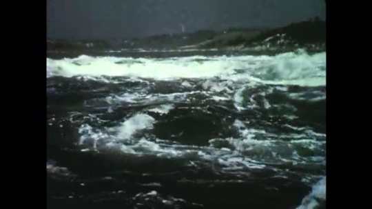 1950s: Waves crash into each other. Raging water, Map with black arrows. Pencil points at map.