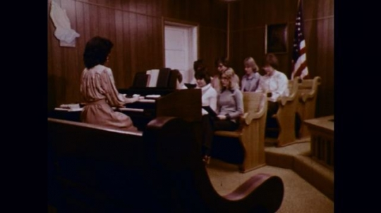1970s: Churchgoers sit in pews and sing; closeup of grimy teeth; adult students sitting in a classroom.