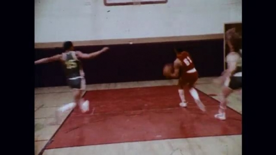 1970s: Basketball game, crowd cheering; microscopic view of organisms.