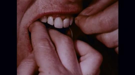 1970s: Teeth bring flossed; teens eating healthy snacks.