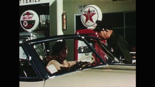 1950s: Man in Texaco uniform talks to woman in car at gas station. He hands a card to a woman on her porch. He talks to a man by a Sky Chief gas pump. Ends with his talking head in Texaco cap.