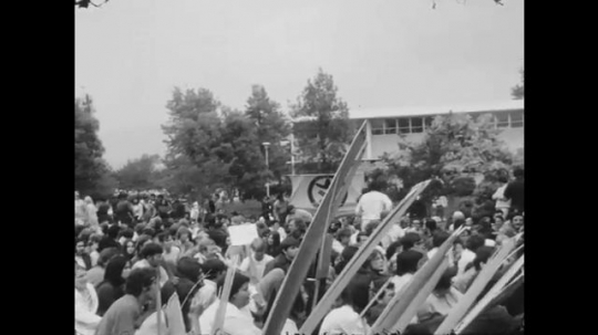 1970s: UNITED STATES: people protest in building grounds