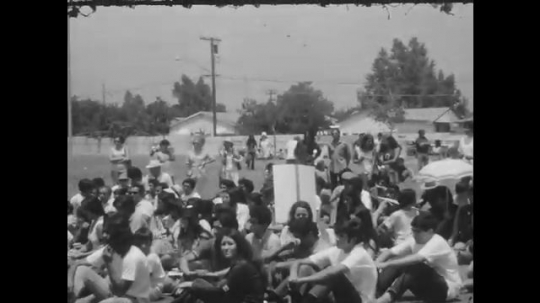 1970s: UNITED STATES: musicians play instruments to protesters.