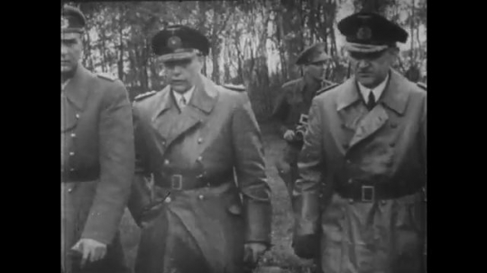 1950s: British soldiers walk. tent sits in field. Field Marshal Bernard Montgomery reads at table with Nazis. General Dwight Eisenhower steps out of car into building and down hall in Reims, France.