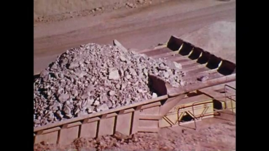 1970s: trucks haul large amounts of construction materials move through site