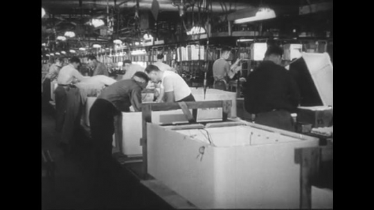 1950s: People work in factory. People at counters. man at Till. People work in field