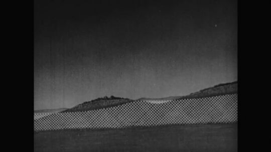 1950s: Cross-hatched animation rises from ground upward on animation of coastal landscape, line appears over hill level. Line over valley darkens.