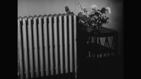 1950s: An animation demonstrates cool air pushing into radiator and warm air blowing out. Arrows demonstrate continuous circulation of air through radiator.