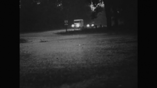 1950s: Cars with headlights on drive in rain. Animation shows air currents combining in clouds.
