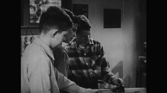 1950s: Boys talk , Boys walk to equipment