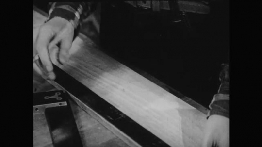 1950s: Hands busy, Hands draw line, Boy saws wood,