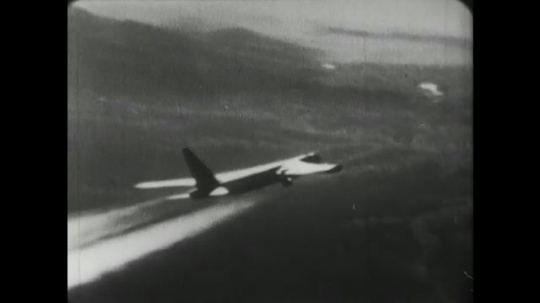 1960s: jet bomber flies through the sky. Contrails behind a group of jets. X-15 plane hangs beneath wing, releases, and drops down as thruster starts.