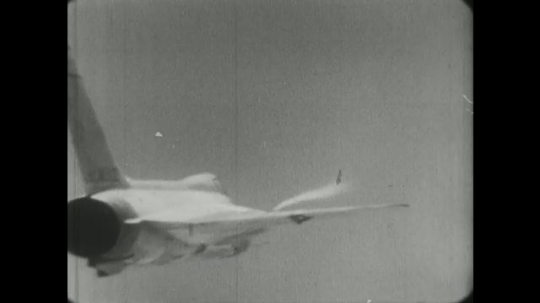 1960s: F5D skylancer flighter jet flies through sky with visible patterns of vortices on wings. airplane wheels roll past emergency vehicles on runway. XB-70 lifts off from runway into the sky.