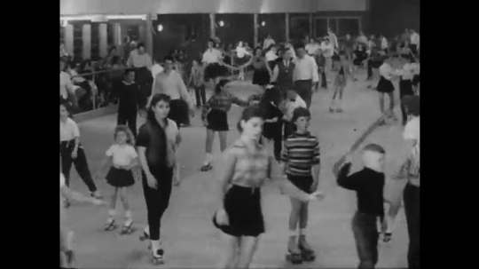 1950s: UNITED STATES: young people skate in rink. School building. People in lecture. Soldiers in uniform skate, Soldiers march in street