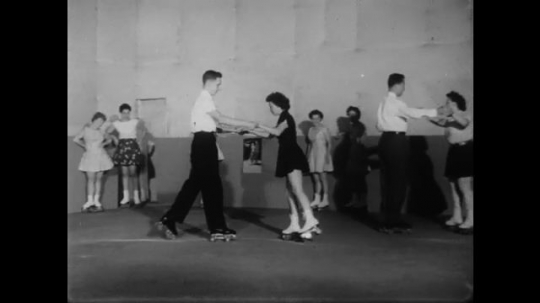 1950s: UNITED STATES: young people skate together as couples. Boy smiles. Lady stretches. Man plays baseball. Man throws ball