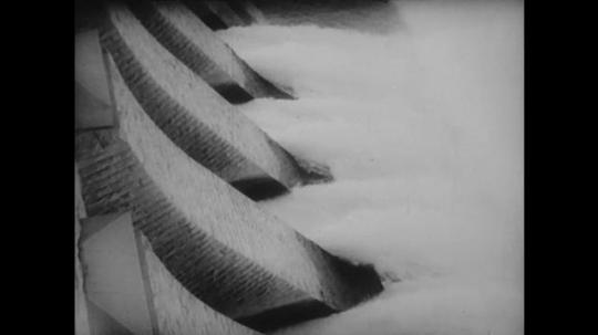 1960s: Water exiting dam. Men walking across dam. View of Aswan Dam. Zhao Enlai exits plane.