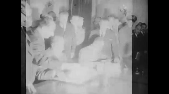 1960s: Gamal Abdel Nasser signing agreement with Shukri al-Quwatli. Nasser and al-Quwatli stand. Nasser and al-Quwatli kiss.
