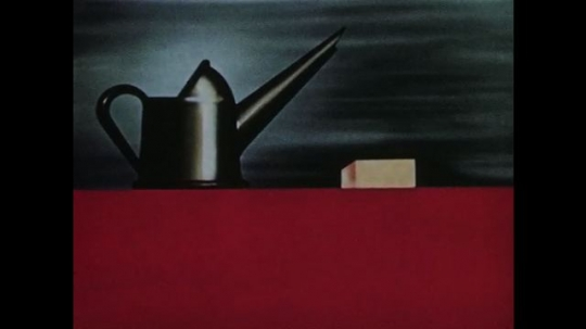 1950s: Animation: oil can drips oil over white block, text