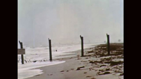1960s: Beach and ocean front. Sky and clouds.