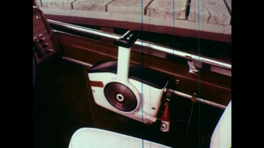 1970s: Hand shifts throttle of motorboat transmission. Hand pushes lever to drive. Hand moves lever to neutral and pulls it back to reverse.