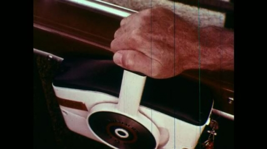 1970s:  Hand moves throttle in reverse. Hand moves throttle back to neutral.