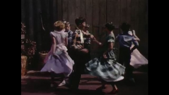 1960s: UNITED STATES: ladies lead in dance. Couples swing. Boys change partners in dance