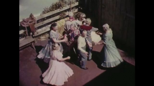 1960s: UNITED STATES: Couples dance square dance. Couples meet in dance. Couples dosedo