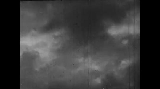 Europe 1940s: lightning in sky. Clouds in sky. Matthew quote