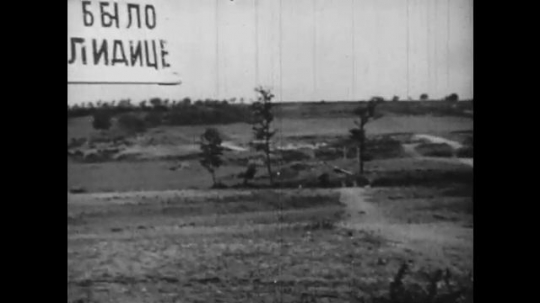Europe 1940s: sign for village. People walk from village after war. People in black clothing
