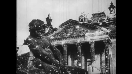 Europe 1940s: damaged building after war. Title quotation. Golden eagle on gate. Ruins title