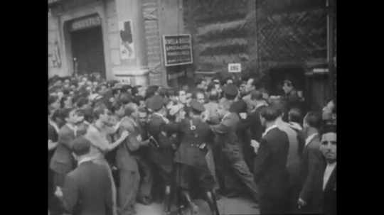 Europe 1940s: crowds push through lines. Angry people. Man fights. People cry