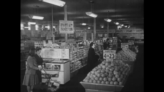 Europe 1940s: ladies shop in supermarket. Sold out sign. Children on swings. Children on slide
