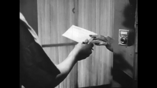 Europe 1940s: hand delivers telegram. Stars on sign. Photos of man in frame