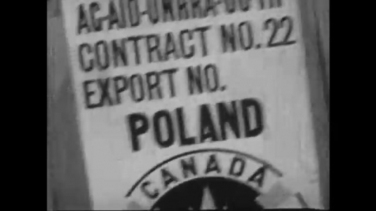 Europe 1940s: Emergency relief supplies in containers for shipping. Blankets, food, and soap in containers