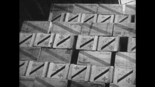 Europe 1940s: supplies piled high in dock warehouse. Children receive food supplies. Man provides supplies