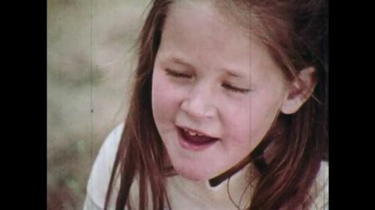 1970s: UNITED STATES: girl speaks. Man speaks to children. Boy speaks. Sign for Smokey bear at zoo