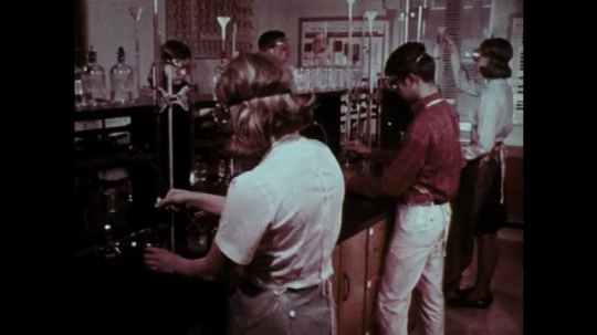 1970s: Students work at laboratory tables.