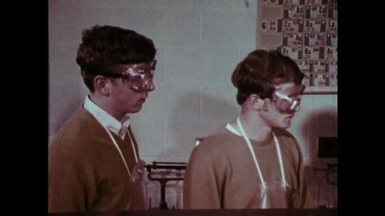 1970s: Boys listen. Man speaks. Boys nod. Man speaks. Boys nod in agreement.