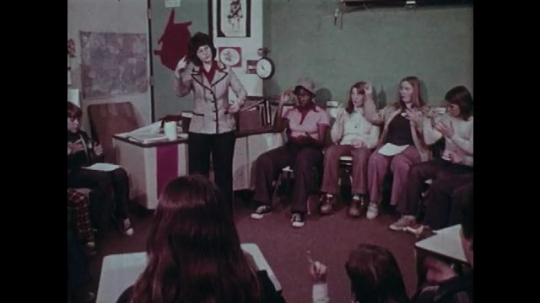 1970s: UNITED STATES: students learn sign language at school. Students make gestures with hands.