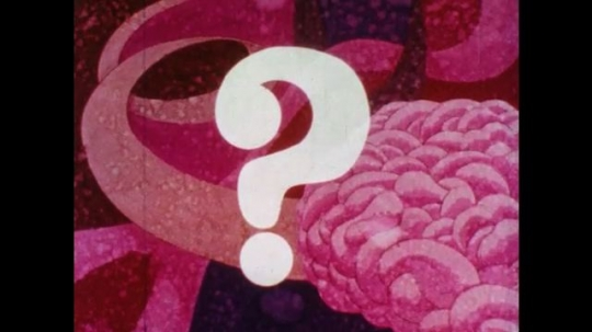 1970s: Question mark appears, man drives up and down pink loops, arrives at brain, squirts liquid at brain.
